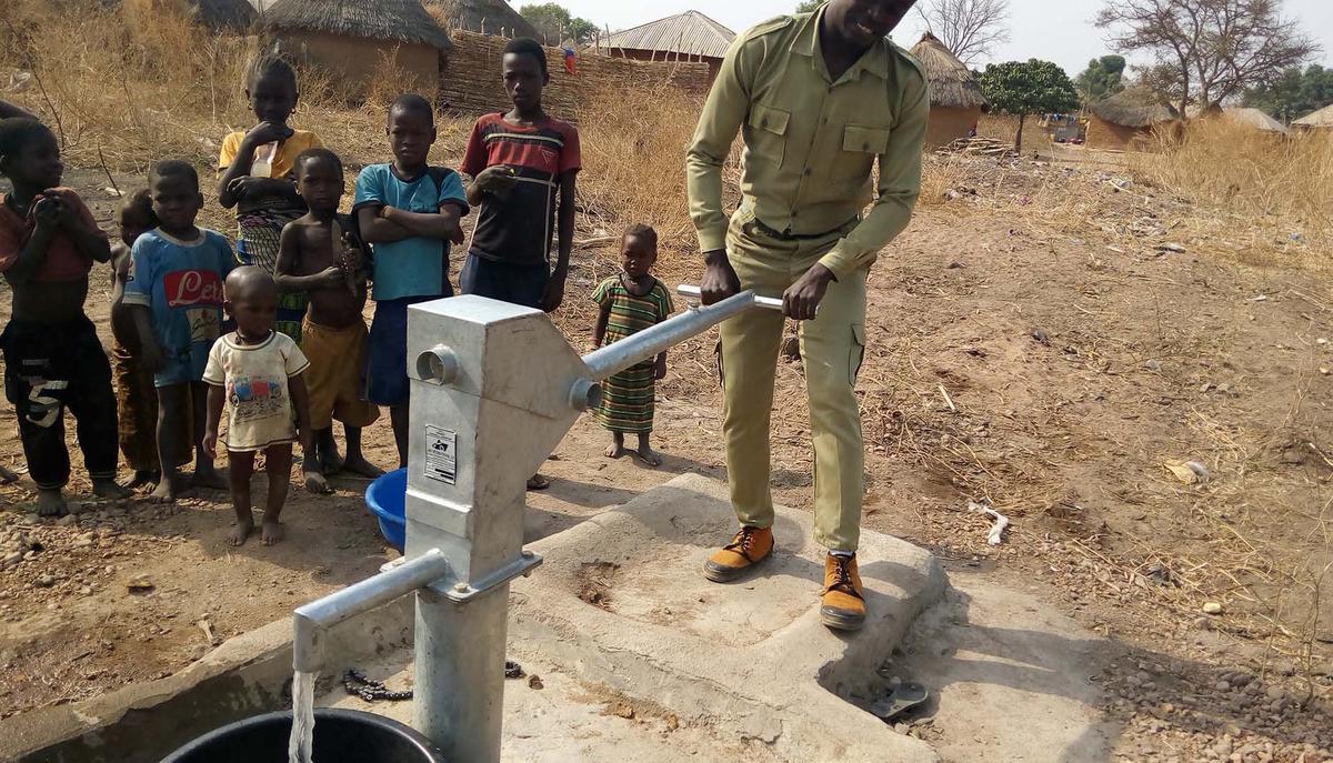 Project facilitator testing the borehole